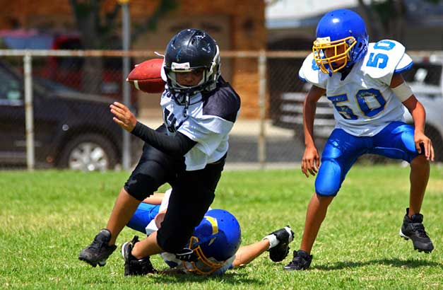 Pressure Mounts to Separate Kids and Football