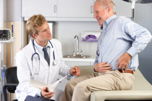 Doctor Examining Male Patient With Hip Pain